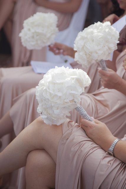 Glamorous Bridesmaid Bouquets -- I like the beading on the stems.