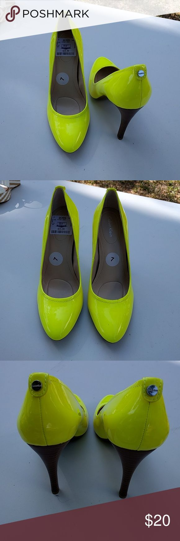 Calvin Klein Neon Yellow High Heels SZ 7 NTW beautiful neon high heel shoes. Slight pointy toe Soft cushion insole Calvin Klein Shoes Heels