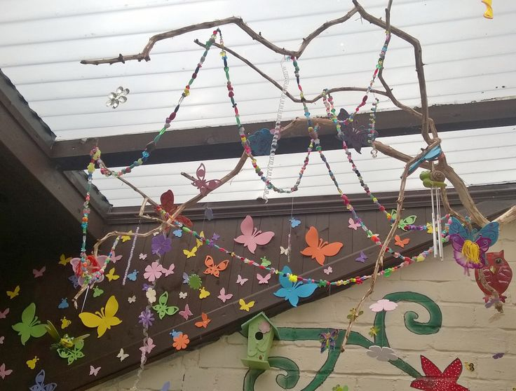 Large branch with beads, flowers & butterfly's on