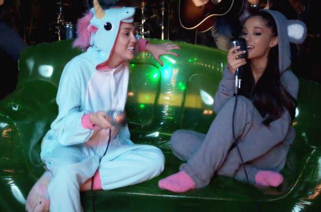 Billboard - Watch Miley Cyrus & Ariana Grande Perform An '80s Classic In Onesies