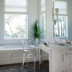 Wayne Windham Architect - bathrooms - tub under window, tub below window, bath under window, bath below window, sheer roller blind, ivory sheer roller blind, white walls, white wall color, espresso tiled floors, espresso floor tile, wainscoting paneled bath, wainscoting paneled tub, marble tub deck, charcoal gray and ivory rug, charcoal gray and ivory patterned rug, ghost chair, acrylic chair, marble counters, marble countertops, marble framed vanity mirror, vanity length mirror, inset…