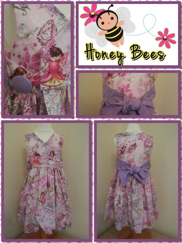 Gorgeous handmade wrap dress - fit for a princess. This dress is sooooo girly, enough twirl with gorgeous Michael Miller fairy print, finished with co-orinating purple bow....  Hope you love it.... xx    Find me at www.facebook.com/honeybeesboutiqueUK