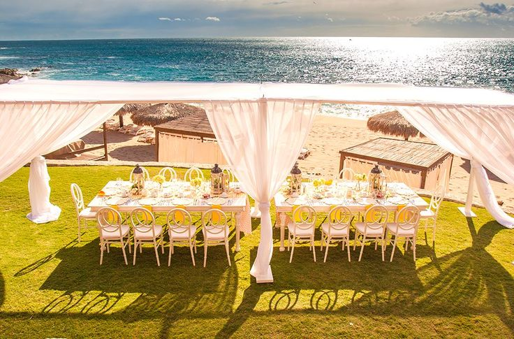 Sheer white fabrics and gorgeous Pacific ocean vistas at Grand Fiesta Los Cabos are wedding goals on Mexico's west coast.