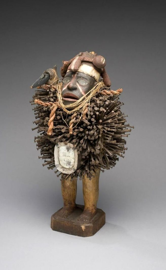 Africa   Power figure from the Woyo people of DR Congo   Wood, pigment, vegetal fibre, glass, mixed metals   ca. 1932; collected in Banana, Bas-Congo    ©African Museum, Belgium