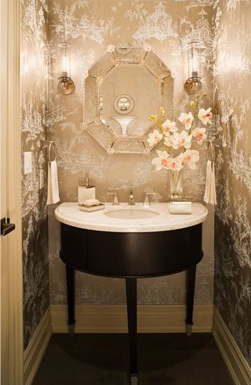 A true jewel-box of a powder room!  The metallic toile wallpaper, faceted mirror and sconces are all elegant touches that will delight your guests.  {image via digsdigs.com}