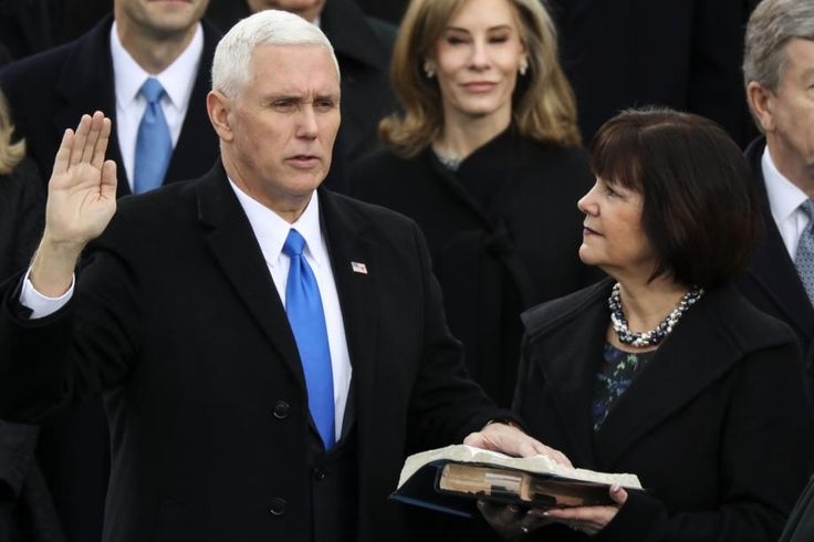 Vice President Mike Pence is sworn in as this wife Karen holds the bible during the 58th Presidential Inauguration at the U.S. Capitol in Washington, Friday, Jan. 20, 2017. (AP Photo/Andrew Harnik)