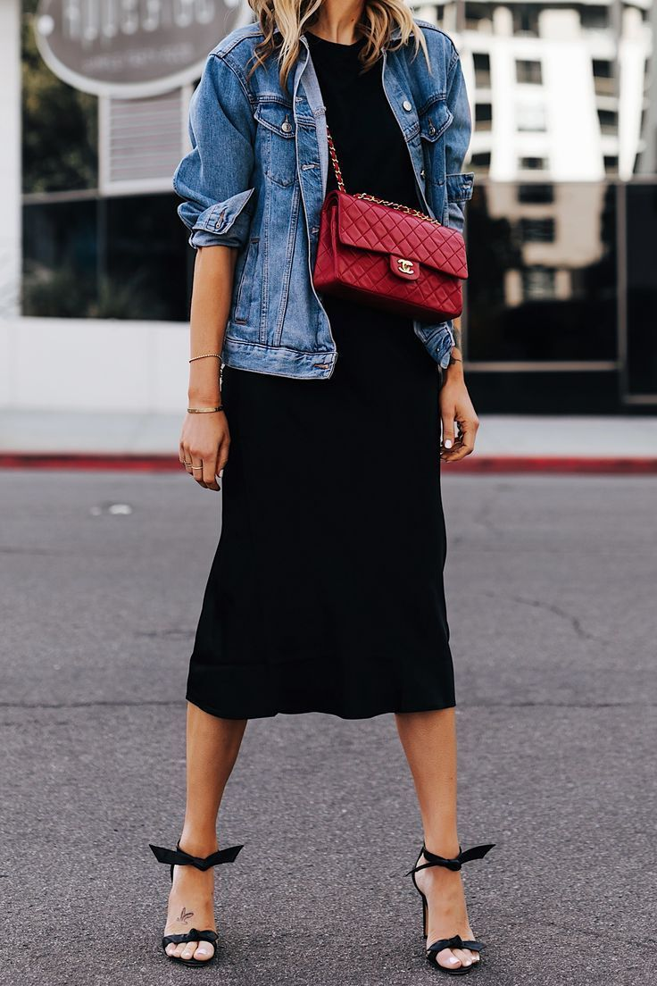 25 +> Fashion Jackson wears denim jacket Black T-shirt Black silk skirt Red