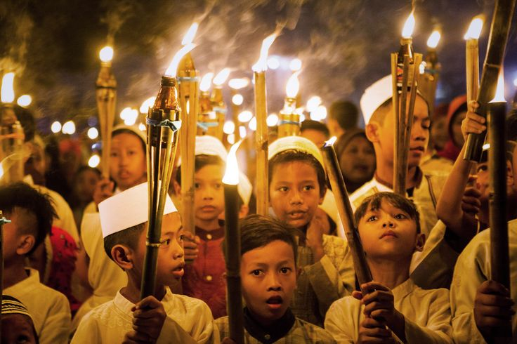 Children carry torches during a procession to celebrate the beginning of the holy month of Ramadan on June 27, 2014 in Jakarta, Indonesia.