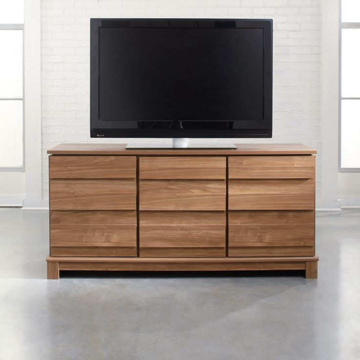 Not all modern furniture is cold chrome and hard edges but this entertainment set has both.