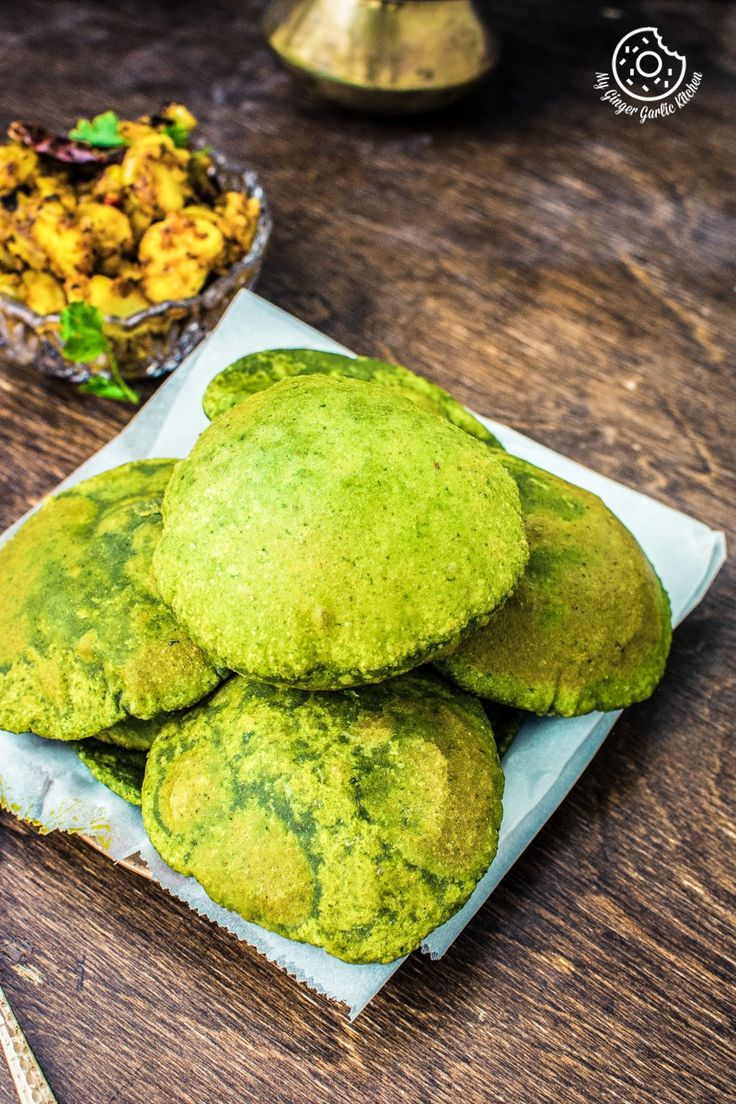 Palak Ki Puri Recipe Video | How To Make Palak Poori | Spinach Puri — This is a deep fried puffed up Indian bread made with 'atta' aka whole wheat flour and spinach puree. These are best served with any curry for a perfect balance of spicy and savory. From: mygingergarlickitchen.com #puri #palakpuri #spinach #poori #bread #fried #festive #gogreen #organic #vegan #homemade #videorecipe #cooking #diwali
