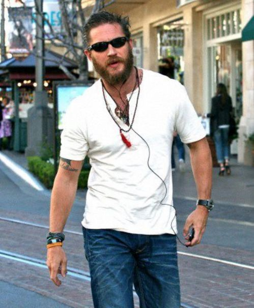 Tom Hardy's street style essentials: Sunglasses. iPod. Necklaces/bracelets. Swagger. <3