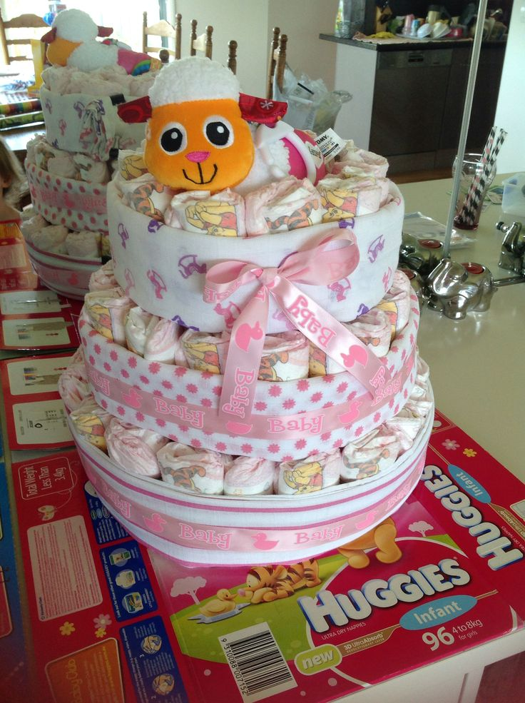 Nappy cake for baby girl... 1 box of nappies, 3 muslin wraps and 1 toy