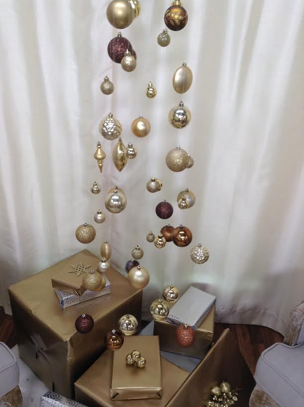 193 best christmas images on pinterest christmas countdown kennethwingard suspends strands of fishing line from the ceiling to make an invisible christmas tree solutioingenieria Choice Image