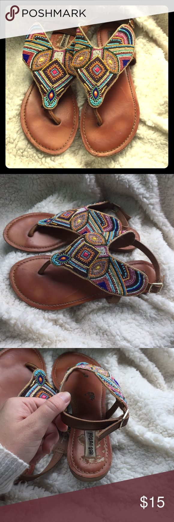 Beaded Sandals I love these sandals! As you can see, these sandals have been worn, but they're still in okay condition. The sole on the right sandal has some wear in it (as pictured)! Beads are all still in tact! #notrated #beadedsandals #supercute #sandals Not Rated Shoes Sandals