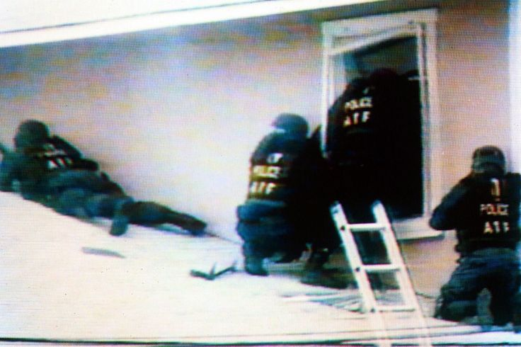 Waco, TX ~  March 1, 1993: Federal officers begin to storm the Davidian compound.