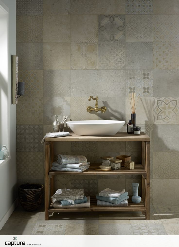 The Moroccan infused patchwork tiles are perfect for the hand crafted artisan interior design trend. Copper wall mounted basin mixer with sit on basin on rustic wood open shelving. The wall and floor tiles are prefect for a wet room solution. Bathroom idea by http://capture.setvisions.co.uk/