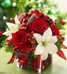 All Wrapped Up for the Holidays. EXCLUSIVE Send a holiday present with real presence: a fresh bouquet of red roses, white lilies, hypericum and assorted fragrant Christmas greens. Hand-designed by our florists in a modern glass cube vase, it's a festive surprise for holiday hostesses, winter birthdays or anniversaries. Rich arrangement of roses, lilies, hypericum and assorted Christmas greens Hand-designed by our florists in a clear glass cube vase lined with red foam and finished with a…
