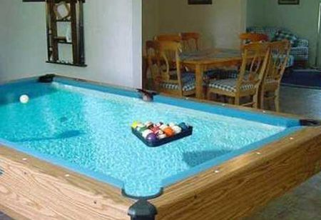 whaaaaaaaaattt!?!?!?? 32 Things You Need In Your Man Cave: a pool table that is also a pool! I want this @dentalschloss