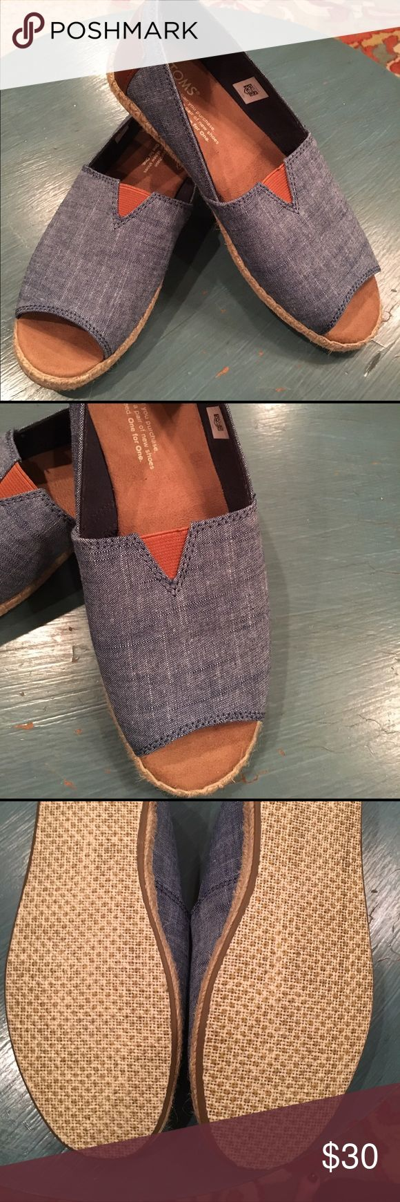 NWOB TOMS chambray espadrille open toe flats These have never been worn! I bought them for a specific outfit and they didn't work and I never got around to sending them back. They are very comfortable and would be great for your upcoming spring break! They are a light blue chambray. TOMS Shoes Espadrilles