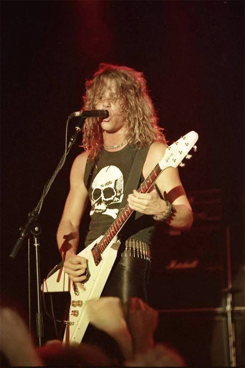 Young James Hetfield with white Flying V