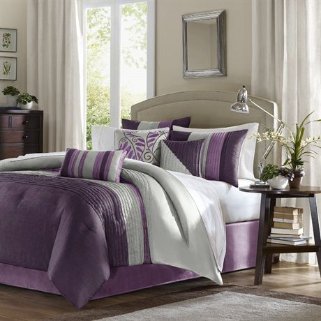 Amherst in Plum is perfect to add a splash of color to your bedroom.  The violet and plum colors are paired back with a silver grey color that add a pop color to your room. The filled piping details that run horizontally across the comforter and vertically on the shams, add texture and dimension this this very simple and clean comforter.  The reverse is magenta purple color.