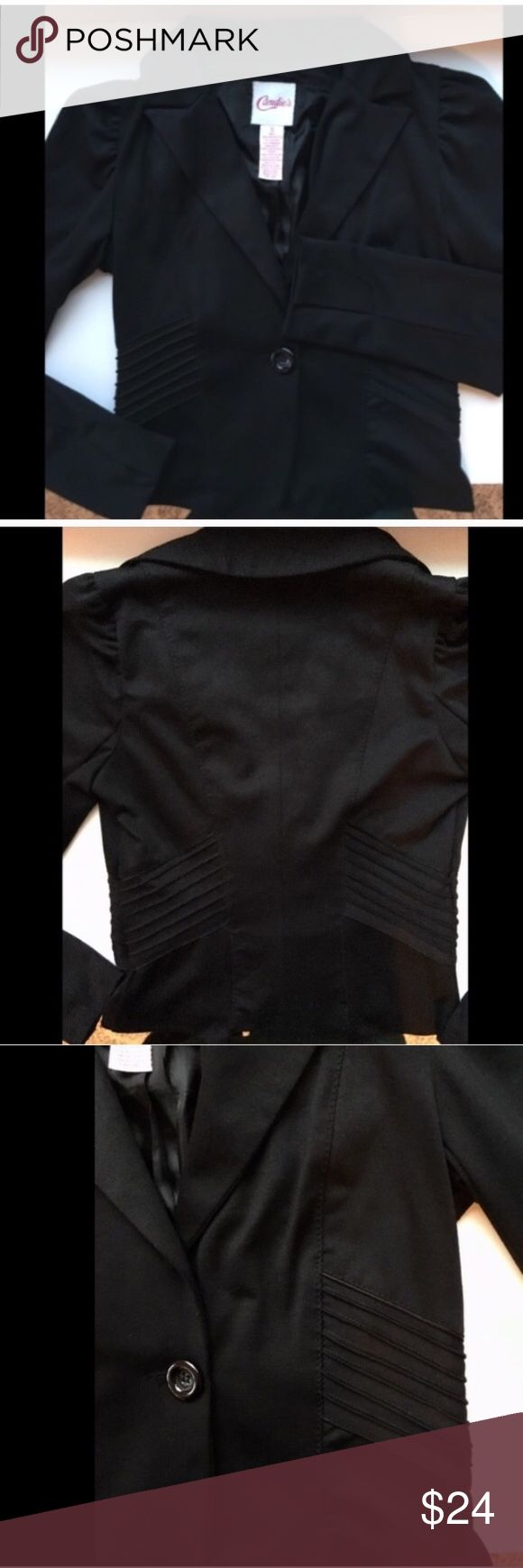 Candies black button up jacket This classy black jacket will complete any outfit! Whether it goes over your favorite dress or worn with jeans and heals. It has only been worn a couple times and looks brand-new. Jacket has a collar and slightly puffed sleeves with one large button to close off the front. Material is 78% polyester, 17% rayon 5% spandex. Contrast 100% polyester lining. Candies Jackets & Coats
