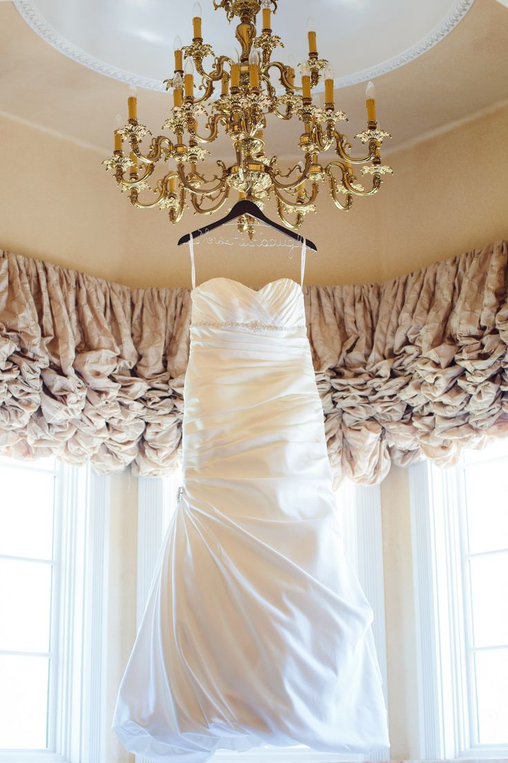 do you invite officiant to wedding reception%0A Wedding dress hanging from a beautiful chandelier  Stefanie Elizabeth  Photography Venue  Santa Ynez Inn and if you need a ceremony officiant call  me at
