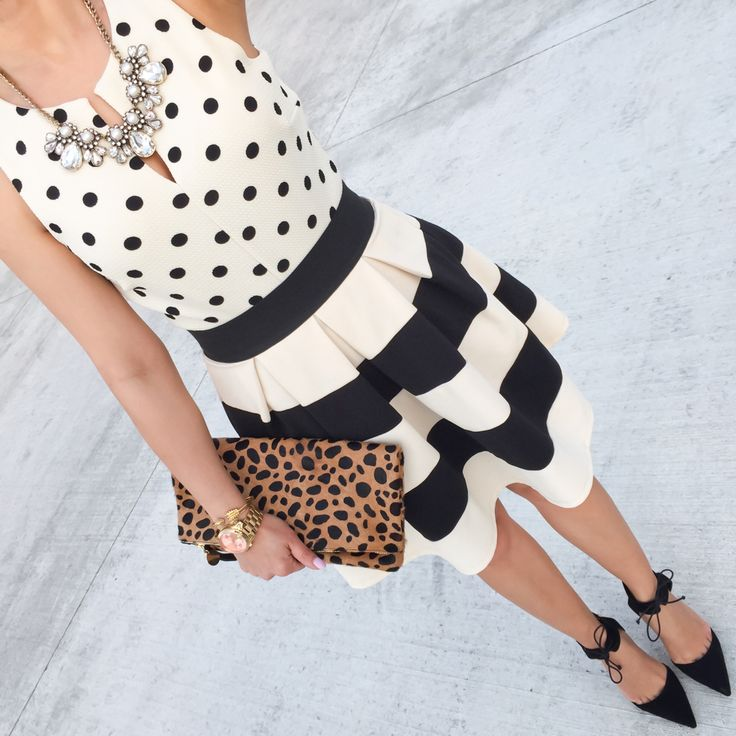 Polka dot top, striped skirt, leopard foldover clutch and bow pumps - pattern mixing spring outfit // http://www.stylishpetite.com/2015/04/daily-outfits-recent-purchases-and-bow.html