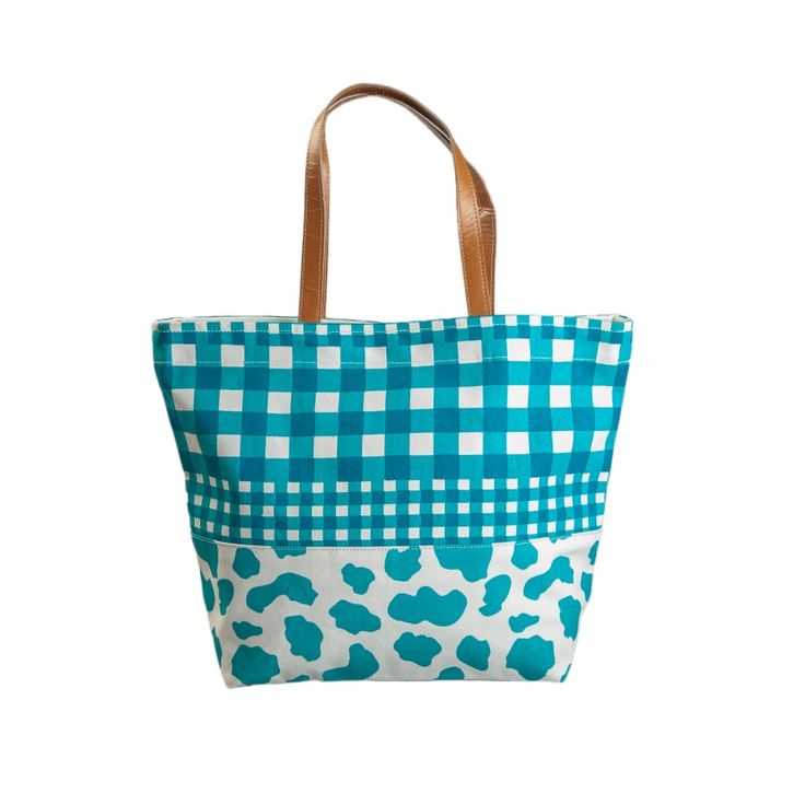 'Rebecca Williams' designed this bag in the warmth of her home in Nottingham while playing the good old game of Chinese checkers with her best friend. With a functional inside pocket, magnetic closures, heavy canvass and genuine leather handles, this bag is for fashion conscious lady who expresses herself without words.  http://www.yologear.co.uk/bags-purses-wallets/shoulder-bags/cow-checker-tote.php