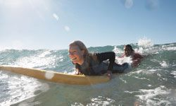 Surfing tips for beginners will help you ride the waves. Learn 10 surfing tips for beginners.
