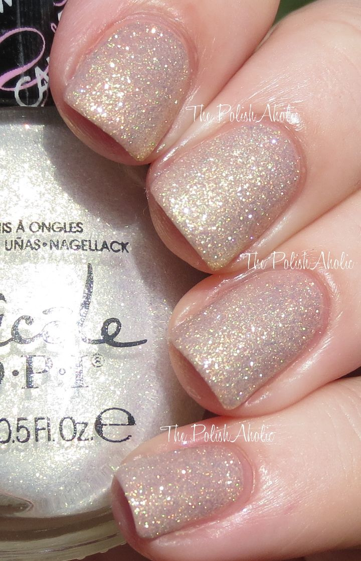 Nicole by OPI Carrie Underwood Collection Swatches Sing You Like A Bee is a golden/white shimmer
