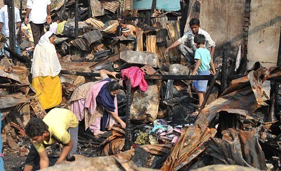 'A Decent Life Is the Train That Hasn't Hit You.' Katherine Boo's spellbinding story of a Mumbai slum. By Elaine Blair, Slate, 2/6/12.