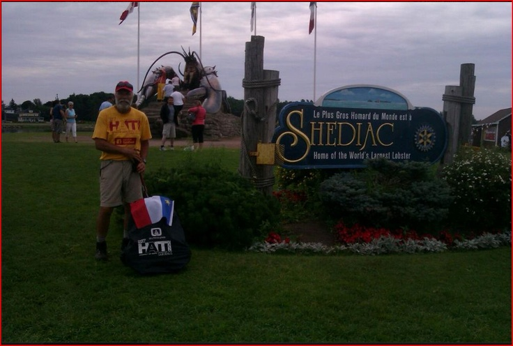 Shediac, New Brunswick - home of the giant lobster and French Canadian culture. I'm displaying the Acadian flag on my pack during the Bonne Fete celebrations.