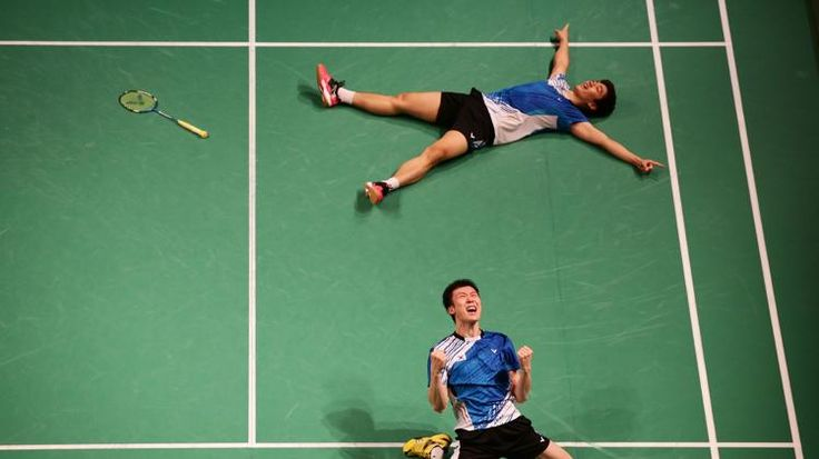 SYDNEY, AUSTRALIA - JUNE 29: Lee Yong Dae Lee (bottom) and Yeon Seong Yoo (top) of Korea celebrate winning the Mens Doubles Final against Lee Sheng-mu and Tsai Chia-Hsin of Chinese Taipei during the Australian Badminton Open at Sydney Olympic Park Sports Centre on June 29, 2014 in Sydney, Australia. (Photo by Matt King/Getty Images)