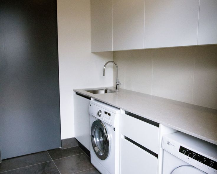 This laundry is an extension of the adjacent kitchen, so all finished followed through to ensure continuity.