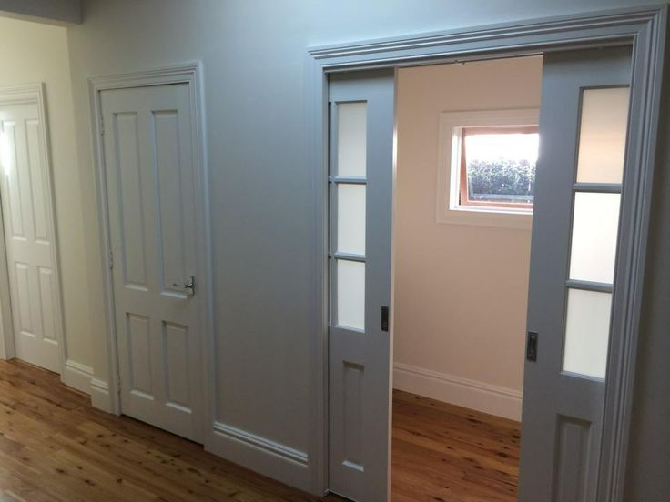 New wall and doors, new window and new flooring. This is the end result of where the double brick wall was removed forming a new study area and a walk in linen/storage.