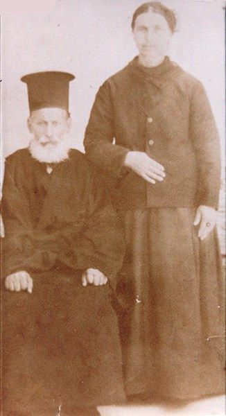 Father Konstantinos Stamboulis, priest of Saint Penteleimon and his wife, Moschonisi 1920.