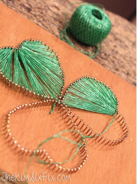String Art Shamrock: How to make patterned string art.  This is just a shamrock made from three hearts.