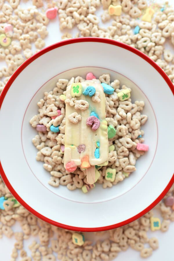 These Lucky Charms Ice Cream Popsicles are great for St. Patrick's Day, National Cereal Day, or just as a summertime ice cream recipe! Easy to make and a kid-friendly recipe! #cerealmilk #milkbar #momofuku #stpatricksday #stpatricksicecream #cerealmilkicecream #stpatricksdayrecipes #stpatricksdayideas #stpatricksdayfood #luckycharms #luckycharmsicecream #icecream #icecreamrecipes #easyrecipes #kidfriendly #kidfriendlyrecipes via @LetsEatCakeBlog