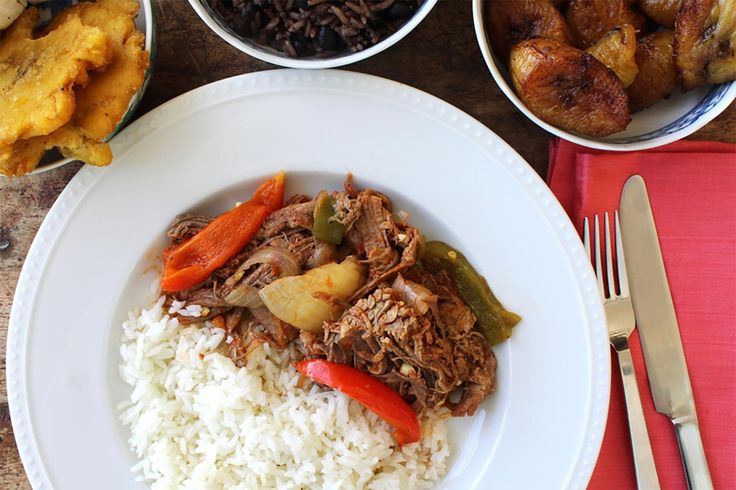 "Ropa Vieja is a traditional Cuban dish – its name literally translates to ""old clothes"" in Spanish because it's a messy, but delicious and colorful, combin..."