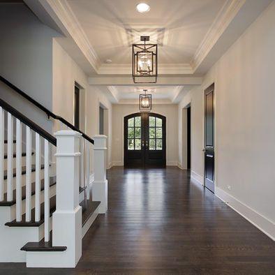 Rustic harwood/laminate, white trim and ebony doors