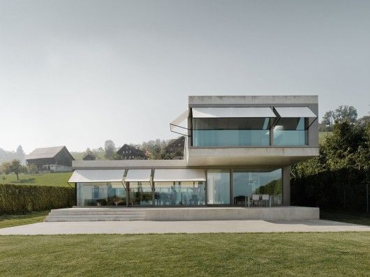 Great sun screens - they retract all the way up to be invisible yet can extend all the way down as a full window cover. Villa M / Niklaus Graber + Christoph Steiger Architekten