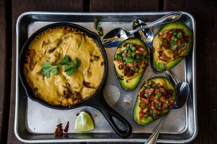 Vegan Baked + Stuffed Avocados with Cashew Queso and Field Roast Sausage - Wicked Healthy