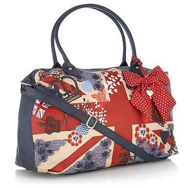 This navy weekender bag from Floozie by Frost French features a red polka dot bow charm, a navy back and a Union Jack print with sketched flower and heart motifs across the front.