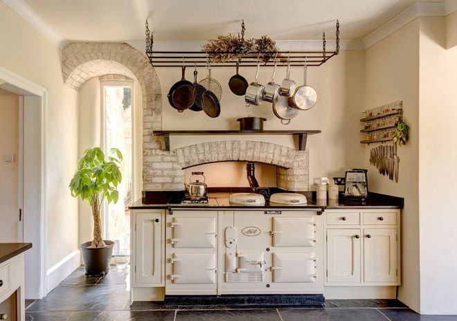 I am completely besotted by that Aga stove in this gorgeous French kitchen. Farmhouse Kitchen by Colin Cadle Photography