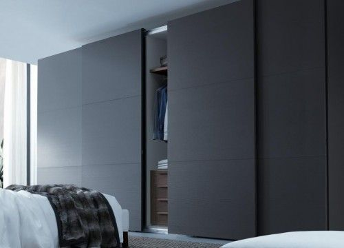 sliding wardrobe design for wider looks of  bedroom