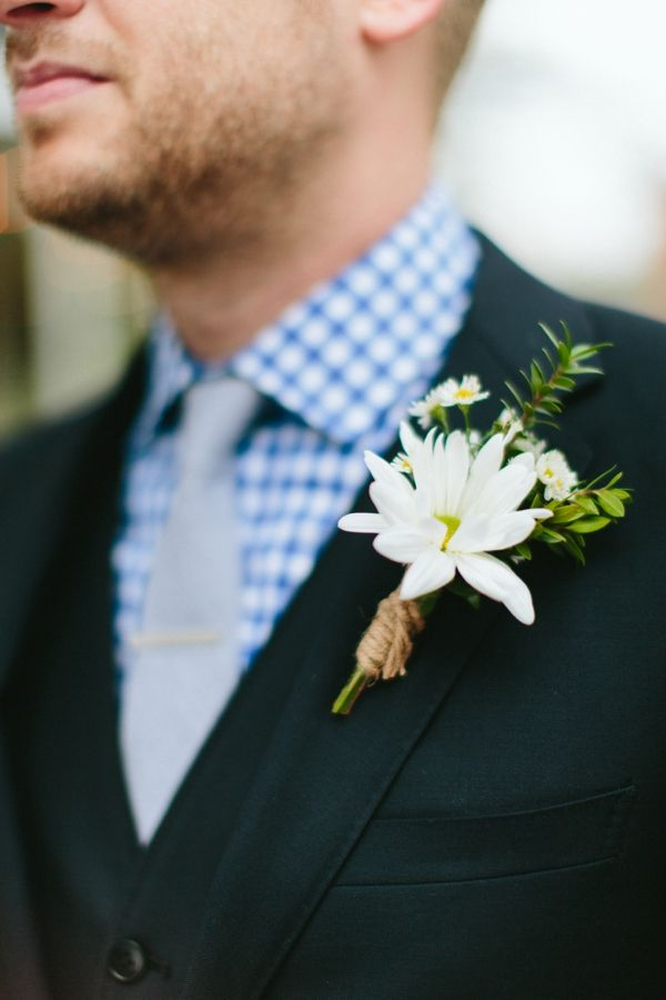 gingham shirt and daisy boutonniere groom look http://www.weddingchicks.com/2014/03/10/unique-and-earthy-wedding/