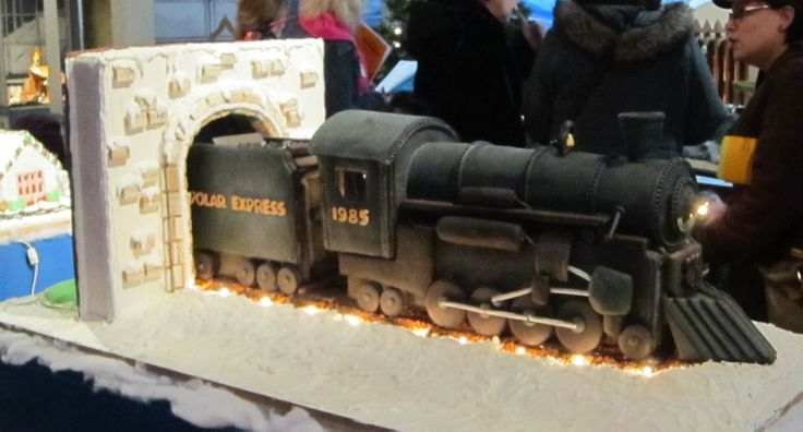 "Adult Division - ""All Aboard the Polar Express."" Materials used: Fondant, sprinkles, ice cream cones, licorice, cinnamon chips, and peanut butter bars."