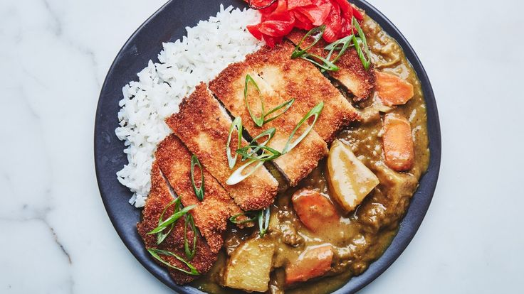 Curry originated in India, but the curry popular in Japan took hold when English merchants brought curry powder to Kobe and other cities to cook with during their stays. It's a bit thick, resembling a stew, and is traditionally seasoned with S&B curry powder and some fruit, for sweetness. A pork cutlet (katsu) is a perfect pairing, but you can substitute chicken instead.
