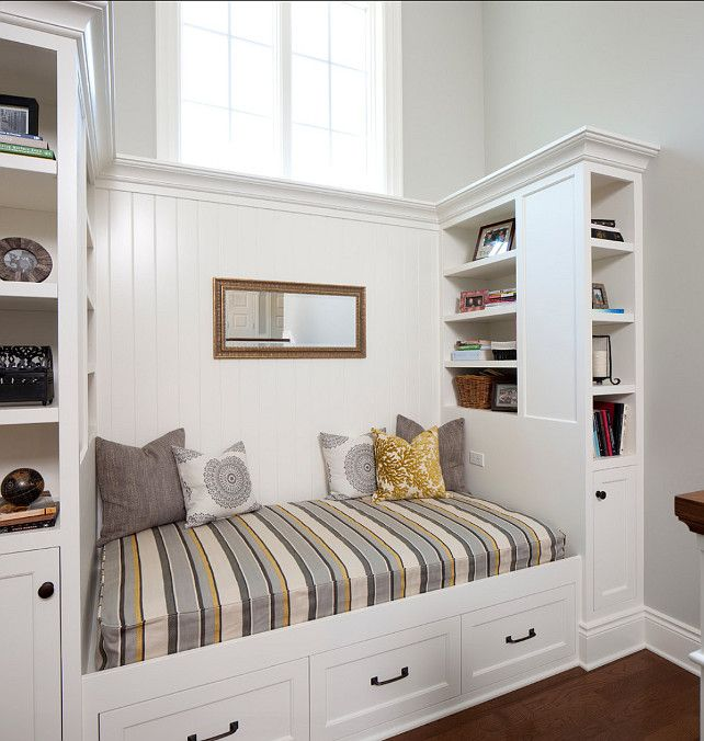 coastal sitting area with white beadbord behind bench and drawer underneath